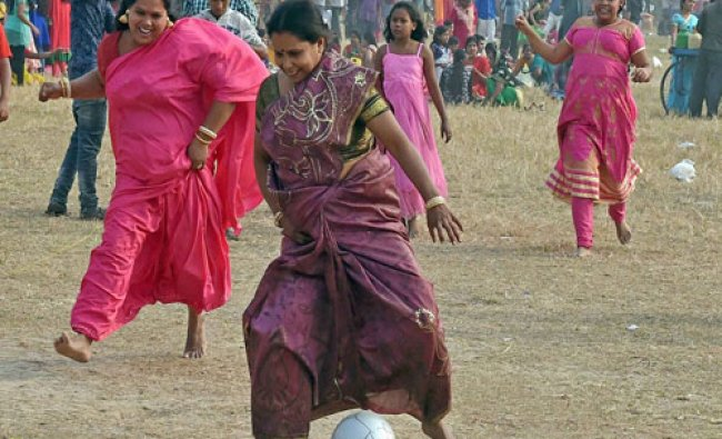 Womens play football on frist day of 2016 in Kolkata on Friday...