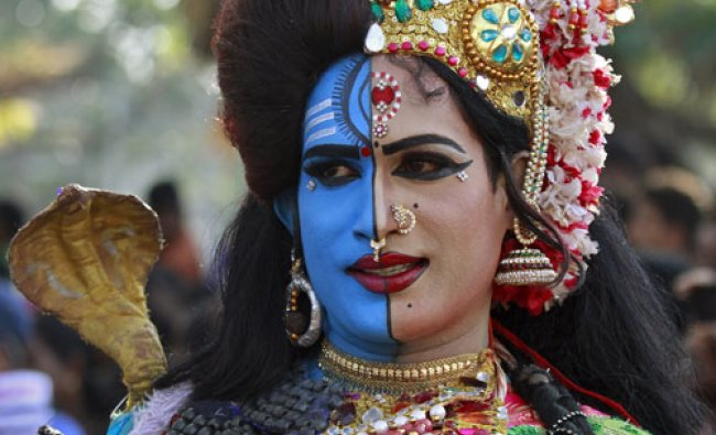 A man dressed as Hindu God Ardhnarishwar takes part in the 32nd Cochin Carnival at Fort Kochi...