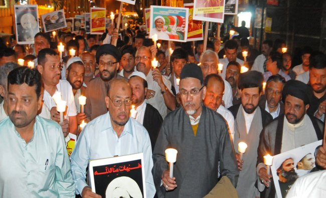 Members of Shia community staging candle light protest...