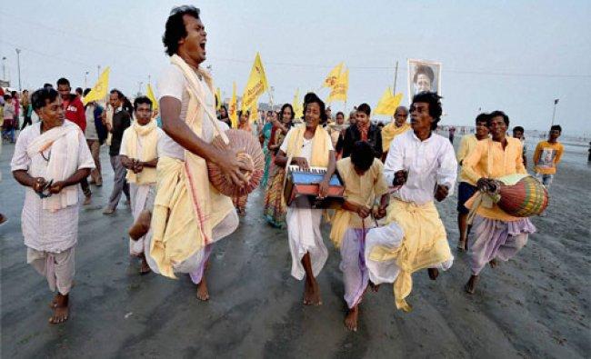 Devotees perform kirtan at Gangasagar on Tuesday ahead of \'Makarsankranti\'...