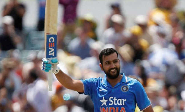 India\'s Rohit Sharma raises his bat after scoring a century during their one day international...