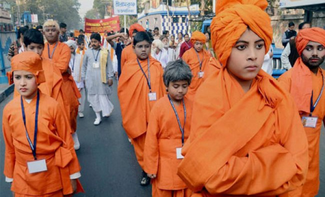 School boys dressed up as Swami Vivekananada take out a procession to celebrate his 153rd birth...