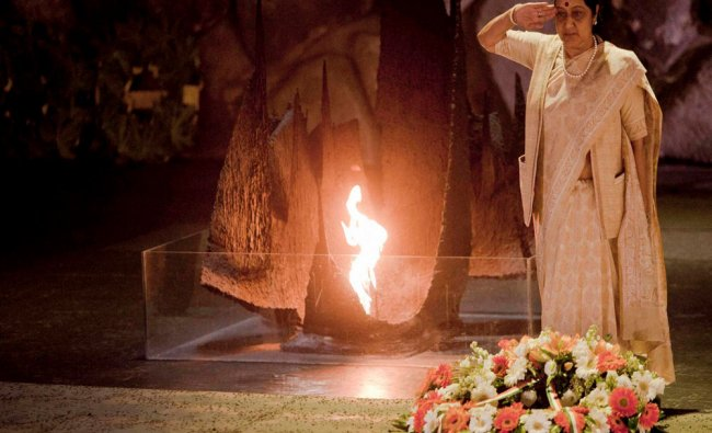 Sushma Swaraj salutes after laying a wreath at the Hall of Remembrance...