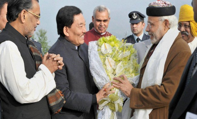 Narendra Modi being welcomed by the Chief Minister of Sikkim Pawan Kumar Chamling...