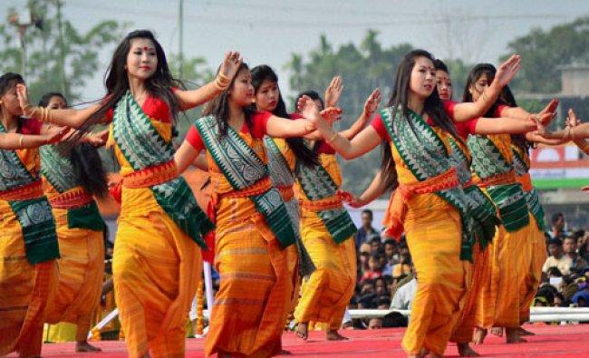 Bodo tribal girls perform traditional Bodo dance during a public rally organized by Bodoland...