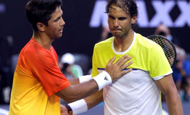 Rafael Nadal, right, of Spain is consoled by compatriot Fernando Verdasco after his first round...