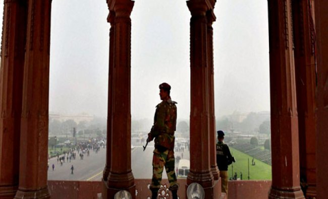 Security personnel keep vigil from South Block during rehearsals for the upcoming Republic Day...