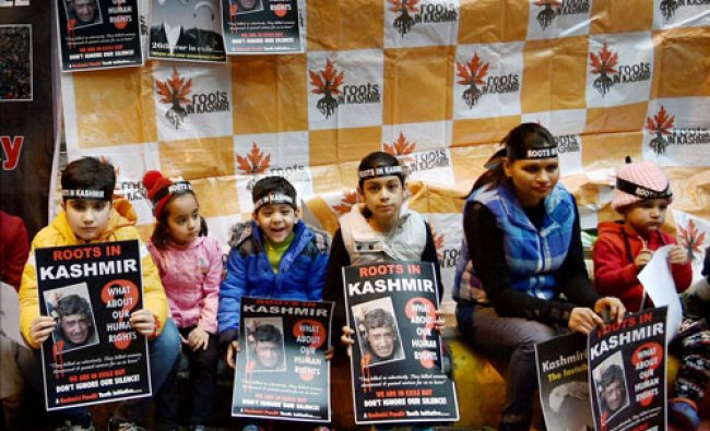 Kashmiri Pandits holding a protest on the occasion of the 26th anniversary of the Kashmiri...