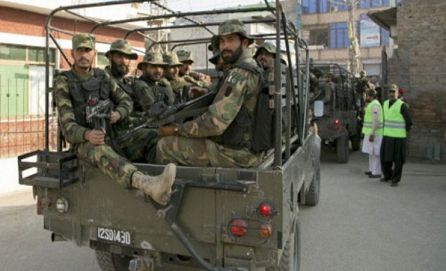 Pakistan army troops arrive at a local hospital where injured people were taken after an attack...