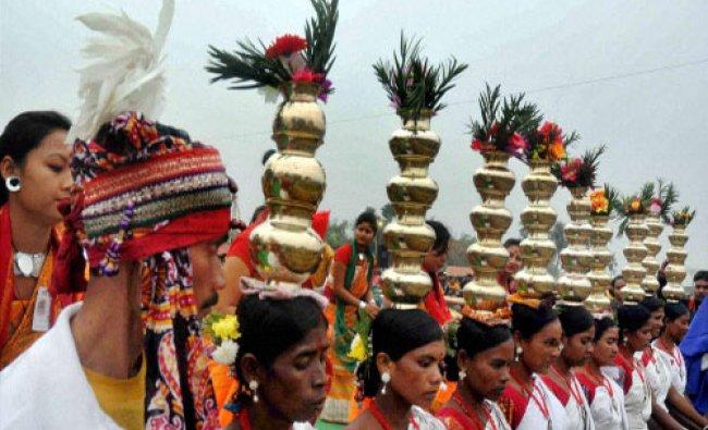 Tribal dancers perform during the inauguration of \'Mati Utsav 2016\', in Burdwan, West Bengal...