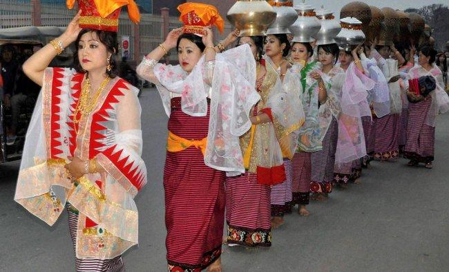 Women devotees take part in a procession to celebrate Emoinu festival in Imphal...