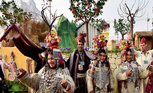 Jammu and Kashmir artists dance in front of their tableau for the Republic Day parade...