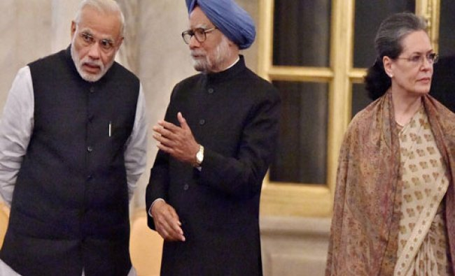 Prime Minister Narendra Modi and former PM Manmohan Singh talks as UPA chairperson Sonia Gandhi ...