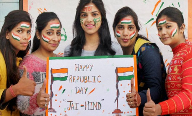 Students paint their faces with tri-colour to celebrate Republic day in Faridabad on Monday...