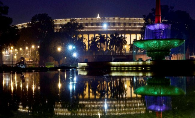 An illuminated parliament building in New Delhi on Tuesday...