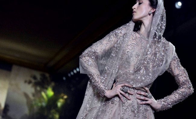 A model wears a creation for Elie Saab\'s Spring-Summer 2016 Haute Couture collection...