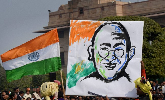 A Tableaux artist of Republic Day Parade showing a photo of Mahatma Gandhi...
