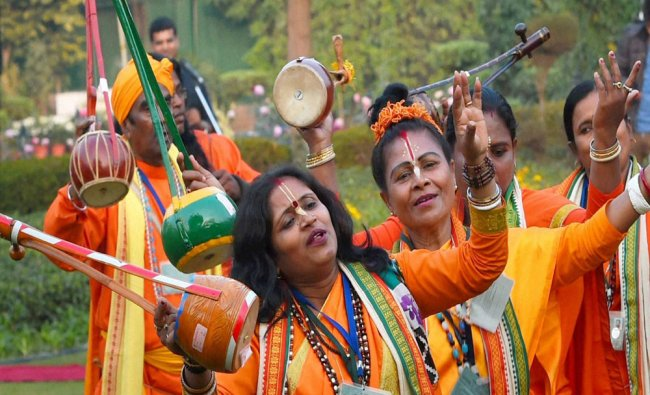 Tableaux artists of Republic Day Parade perform during a meeting with Vice President....