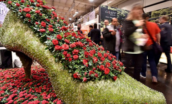 A giant women\'s shoe is made of flowers is on display at the international trade fair...
