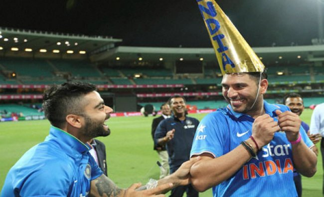 India\'s Virat Kohli laughs with Yuvraj Singh during celebrations after they won the T20 Internatio..
