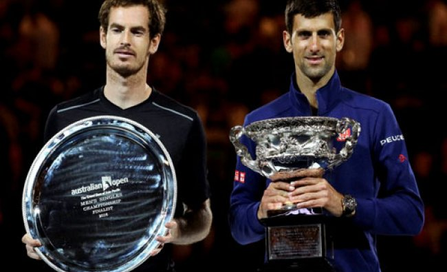 Novak Djokovic, right, of Serbia holds his trophy after defeating Andy Murray, left, of Britain ...