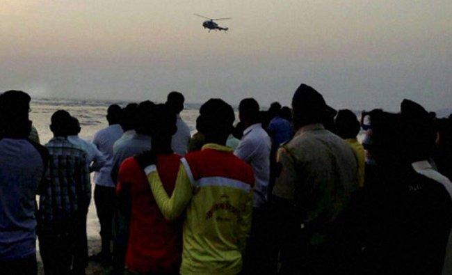 A Coast Guard helicopter helping in rescue works at Murud Janjira beach near Alibaug ...
