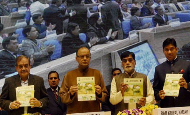 Union Finance Minister Arun Jaitley, Rural Development Minister Chaudhary Birender Singh (L), Mini..