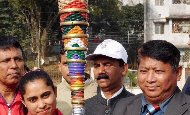 Tripura Youth Affairs and Sports official and gymnast girl Dipa Karmakar receive the Torch which ...