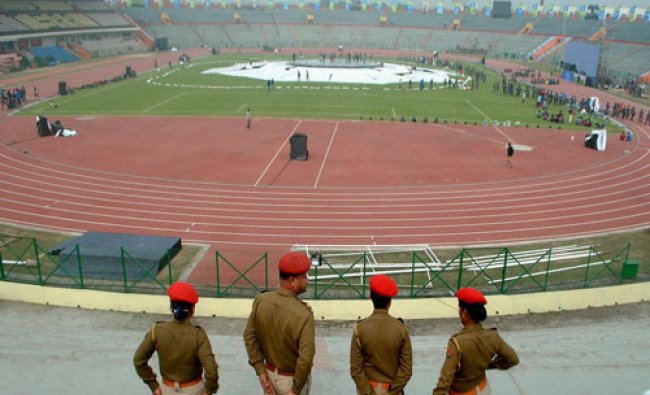 Police personal keep vigil at Indira Gandhi Athletic Stadium during a rehearsal for the 12th South..