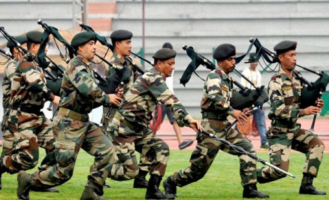 Assam Rifles jawan rehearse for the opening ceremony of the 12th South Asian Games at Indira Gandh..