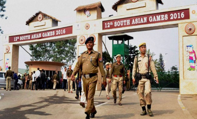 Security personnel keep a tight vigil at the main entrance to Indira Gandhi Athletics Stadium in ...