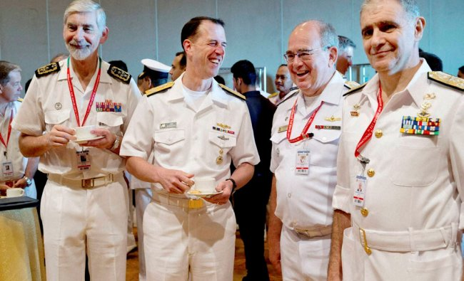 U.S. Chief of Naval Operations John Richardson, second left, shares...
