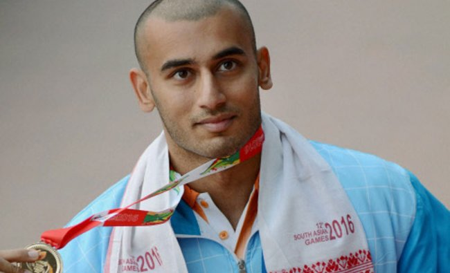 Veerdhawal Khade during the presentation ceremony for the 50m b fly swimming event...