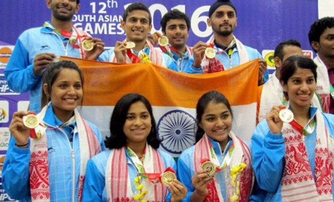 Indian Women and Mens Squash team posing for photograph with their Gold medals...