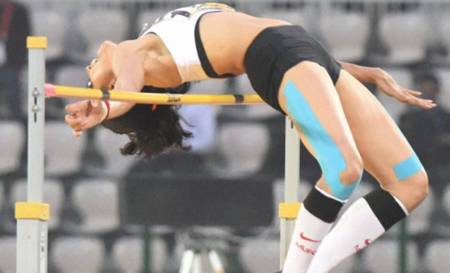 Sahana Kumari of India jumps in her final attempt of the High Jump event...