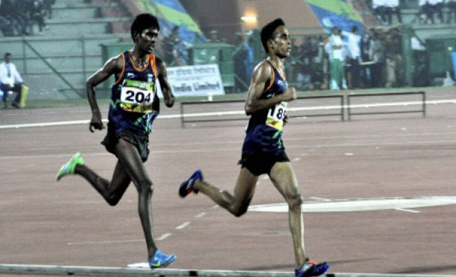 T Gopi of India winner of gold medal (front ) and Suresh Kumar of India winner of silver medal...