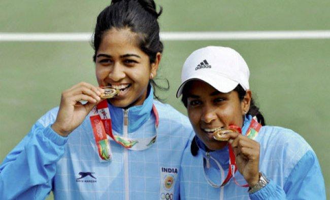 Gold medal winners Prarthana Thombare and Sharrmadaa Baluu of India, pose during the presentation...