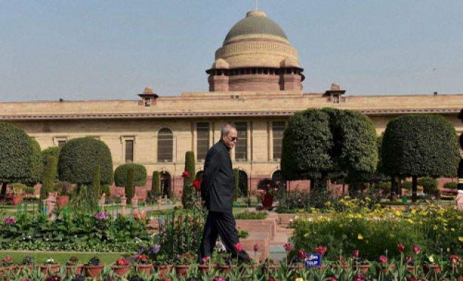 President Pranab Mukherjee walks at the Mughal Gardens at Rashtrapati Bhavan during its press...