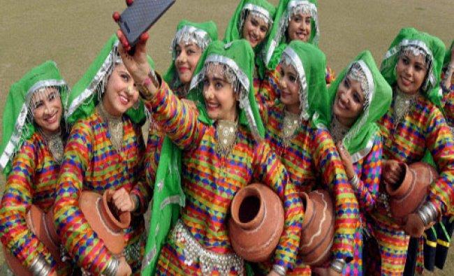 Girls taking selfie during the lok Mela at Punjabi University in Patiala...