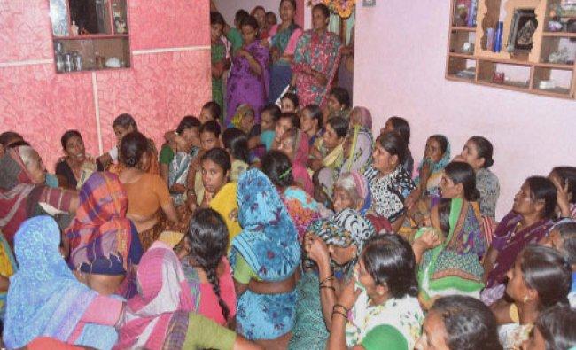 Relatives of Lance Naik Hanumanthappa Koppad mourn his death at his home in Betador in Hubli...