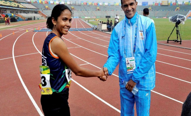 Kavita Raut and Niotendra Singh Rawat of India shake hands during the 12th South Asian games 2016...