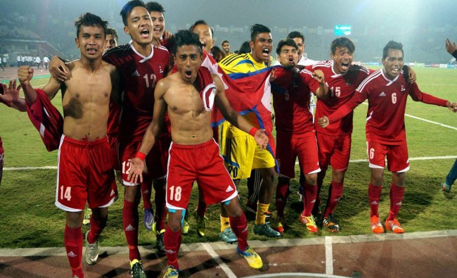 Nepal team players celebrate their win against India after...