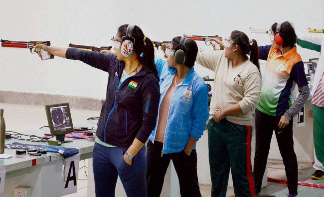 Shooters take part in the Final of the 10m Air Pistol Women\'s...