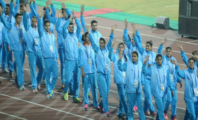 Indian contingent marching past at the closing ceremony of the 12th South Asian Games in...