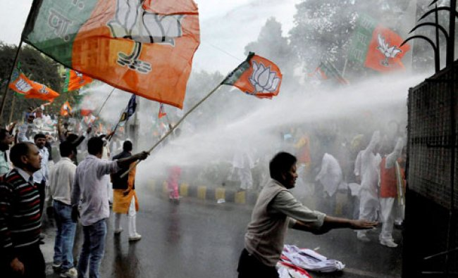 Police use water cannons to disperse NDA activists during their \'Aakrosh March\' in protest...