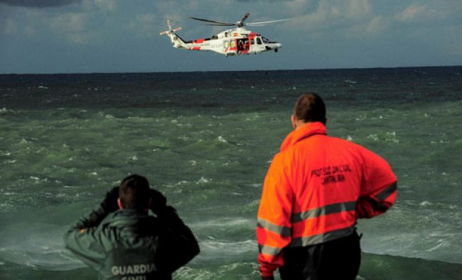Search and rescue teams searches the coast line, looking for a man reported missing on Saturday...