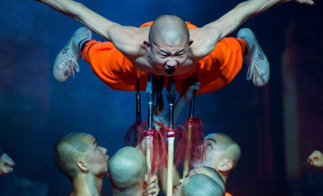 Shaolin monks perform during their Shaolin Warriors The Magical Secret 20th Anniversary...