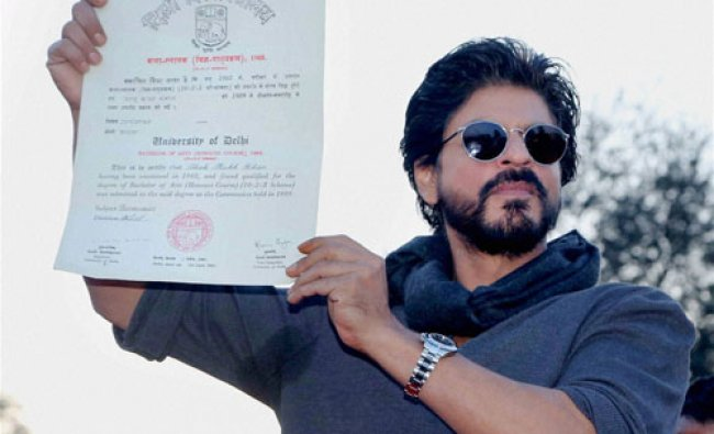 Actor Shahrukh Khan showing his graduation degree of 1989 which he received at Hansraj...
