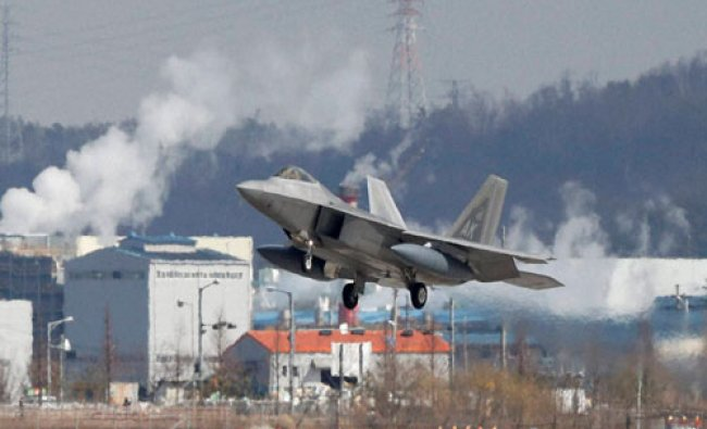 One of four U.S. F-22 stealth fighters prepares to land at Osan Air Base in Pyeongtaek...