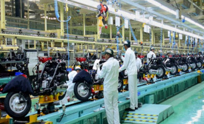 Workers at the newly inagurated Honda two-wheelers plant at Vithalapur on Wednesday. The plant...